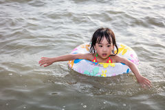 Asian Chinese little girl swimming at the seaside Stock Photography