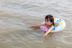 Asian Chinese little girl swimming at the seaside Stock Images