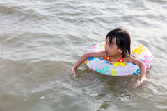 Asian Chinese little girl swimming at the seaside Royalty Free Stock Image