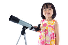 Asian Chinese little girl with telescope Stock Photo
