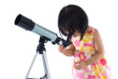 Asian Chinese little girl with telescope Royalty Free Stock Photo