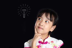 Asian Chinese little girl thinking with bulb sketch royalty free stock photos