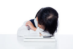 Asian Chinese little girl in uniform playing with tablet compute Royalty Free Stock Photos