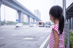 Asian Chinese little girl waiting for a bus Royalty Free Stock Photo