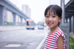Asian Chinese little girl waiting for a bus Stock Image
