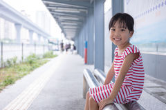 Asian Chinese little girl waiting for a bus Stock Photos