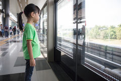 Asian Chinese little girl waiting for transit Royalty Free Stock Photography