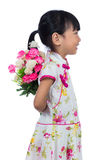 Asian Chinese little girl wearing cheongsam holding carnations f Royalty Free Stock Images