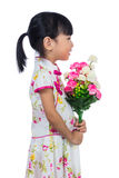 Asian Chinese little girl wearing cheongsam holding carnations f Stock Photography