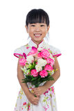 Asian Chinese little girl wearing cheongsam holding carnations f Stock Photo