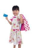 Asian Chinese little girl wearing cheongsam holding shopping bag Royalty Free Stock Photos