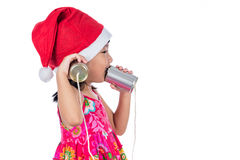 Asian Chinese little girl wearing santa hat holding tin can Stock Images