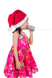 Asian Chinese little girl wearing santa hat holding tin can Stock Photos