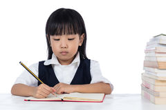 Asian Chinese little girl wearing school uniform studying Royalty Free Stock Image