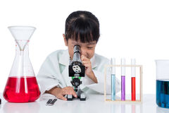 Asian Chinese little girl working with microscope Stock Photos