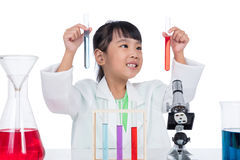 Asian Chinese little girl working with test tube Royalty Free Stock Photography