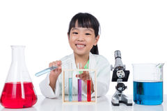 Asian Chinese little girl working with test tube Royalty Free Stock Photo