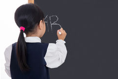 Asian Chinese little girl writing on blackboard. In isolated white background Royalty Free Stock Photography