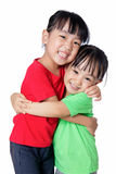 Asian Chinese little girls hugging each other Stock Image
