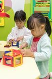 Asian Chinese little girls playing colorful magnet plastic block Royalty Free Stock Photography