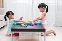 Asian Chinese little girls playing kinetic sand at home Royalty Free Stock Images