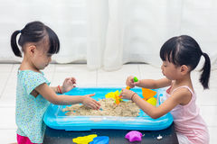 Asian Chinese little girls playing kinetic sand at home Stock Images