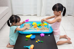 Asian Chinese little girls playing kinetic sand at home Stock Photography