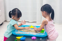 Asian Chinese little girls playing kinetic sand at home Royalty Free Stock Photography