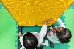 Asian Chinese little girls playing pin board. At indoor playground Royalty Free Stock Photography