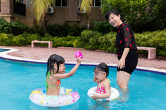 Asian Chinese Little Girls Playing in the Swimming Pool Royalty Free Stock Photography