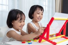 Asian Chinese little girls playing toys stock image