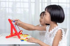 Asian Chinese little girls playing toys stock photo