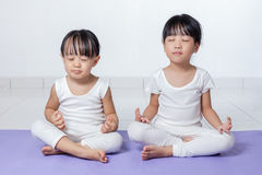 Asian Chinese little girls practicing yoga pose stock photography