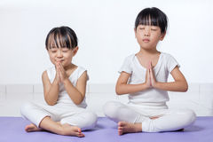 Asian Chinese little girls practicing yoga pose Royalty Free Stock Image