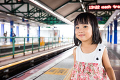 Asian Chinese Little Girls Waiting for Light Rapid Transit Stock Images
