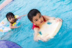 Asian Chinese Little Kids Playing in the Swimming Pool Royalty Free Stock Photography
