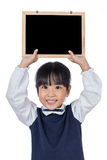 Asian Chinese little primary school girl holding chalkboard Stock Image