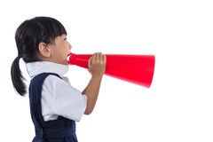 Asian Chinese little primary school girl holding retro megaphone Royalty Free Stock Photos