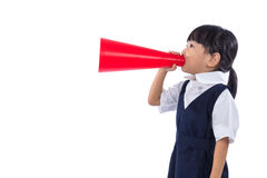 Asian Chinese little primary school girl holding retro megaphone Stock Image