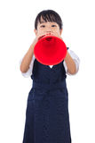 Asian Chinese little primary school girl holding retro megaphone Royalty Free Stock Photo