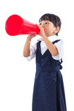 Asian Chinese little primary school girl holding retro megaphone Royalty Free Stock Photography