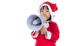 Asian Chinese little santa girl holding loudspeaker shouting Stock Photo