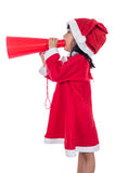 Asian Chinese little santa girl holding loudspeaker shouting Royalty Free Stock Photos
