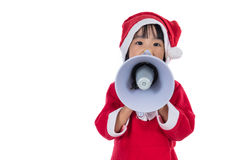 Asian Chinese little santa girl holding loudspeaker shouting Royalty Free Stock Image