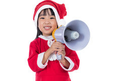 Asian Chinese little santa girl holding loudspeaker shouting Stock Images
