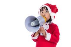 Asian Chinese little santa girl holding loudspeaker shouting Stock Images