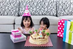 Asian Chinese little sister with celebrating birthday. At home indoor stock photos
