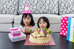 Asian Chinese little sister with celebrating birthday. At home indoor royalty free stock photography