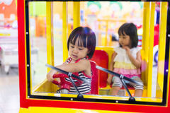 Asian Chinese Little Sister Driving Toy Bus Royalty Free Stock Images
