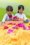 Asian Chinese Little Sister Playing Kinetic Sand. At Indoor Playground Stock Images